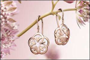beauty and femininity highlight the fine jewellery omega flower c...